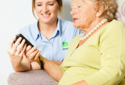 Assessor advising an elderly patient on specialist seating