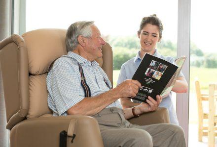 Elderly man in specialist seating